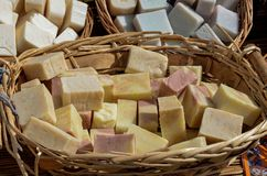 Handmade soap stacked in wicker basket Royalty Free Stock Photo