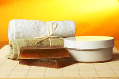 Handmade soap, towels and Cream on the bamboo mat. Spa Concept: herbal handmade soap, towels and Cream on the bamboo mat Stock Photography