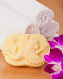 Handmade soap, towels and orchid Stock Images