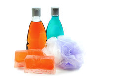 Handmade soap, two bottle of shower gel  and soft bath puff or sponge. Royalty Free Stock Photography