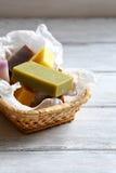 Handmade soap in a wicker basket Stock Image