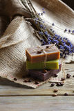 Handmade soap on wooden boards with coffee beans Stock Images