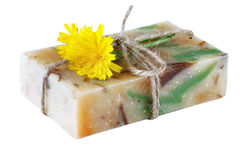 Handmade soap and yellow flower isolated Stock Photography