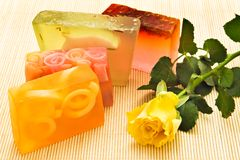 Handmade soaps. And yellow rose royalty free stock photos