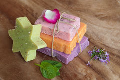 Handmade soaps. Of different colors on wood Stock Photo