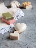 Handmade soaps and elegant towel. Stock Photography