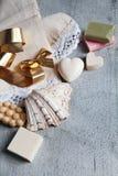 Handmade soaps, elegant towel, shell and golden bow. Stock Photos