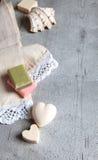 Handmade soaps, elegant towel, shell. Stock Photo