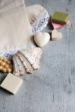 Handmade soaps, elegant towel, shell. Royalty Free Stock Photos