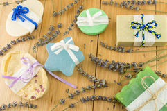 Handmade soaps with ribbons. Colorful handmade soaps with ribbons on a wooden table Stock Photo