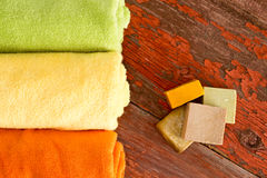 Handmade Soaps and Towels on Wooden Table Stock Photography