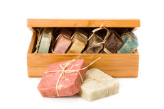 Handmade soaps in wooden box. Isolated on white background Royalty Free Stock Images