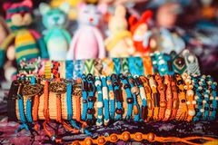 Handmade souvenir bracelets at the street market royalty free stock images