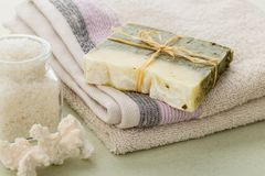 Handmade spa olive oils and dried herbs soap on towel Royalty Free Stock Photos