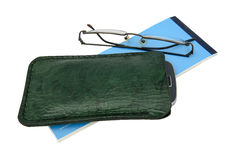 Handmade spectacle case. Handmade, green leather mobile case and spectacles with a blue cheque book Stock Photography