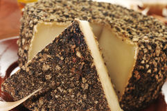 Handmade spice-coated cheese from Spain Royalty Free Stock Image