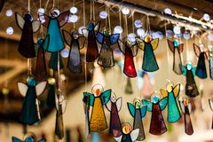 Handmade stained glass angel shaped Christmas decorations. A view of an original hand made glass decorations for Christmas and New Year. Indoor decor for royalty free stock images