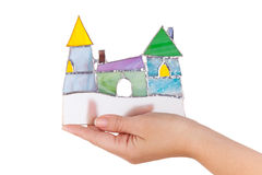 Handmade stained glass colorful castle in hand isolated o Royalty Free Stock Photos