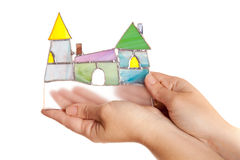 Handmade stained glass colorful castle in hands isolated Stock Photos