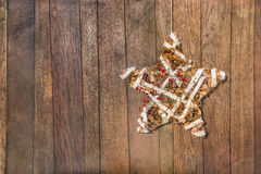 Handmade star for celebration  on wooden board Royalty Free Stock Photography