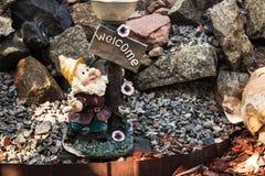 Handmade statue of small gnome in garden Stock Photos