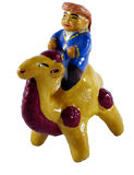 Handmade statuette of a camel rider. Hand made statue of Kazakh rider on a camel on white background Stock Image