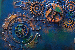 Handmade steampunk background mechanical cogs wheels clockwork.  Stock Photos