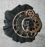 Handmade steampunk brooch with a skull. Bronze decorative elements and black lace Royalty Free Stock Images