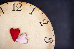 Handmade stitched hearts on a clock Royalty Free Stock Photography