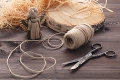 Handmade straw angel. Making of handmade straw angel on table Royalty Free Stock Image