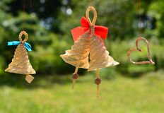 Handmade straw decorations against summer plants background Royalty Free Stock Image