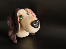 Handmade stuffed dog toy. Handmade beautiful stuffed toy of slightly mournful eyes Stock Photos