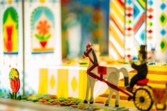Handmade caramel horse and wagon in showcase. Handmade sugar caramel horse and wagon in showcase of candy store closeup, nobody. Treats for children. Sweet Stock Photo