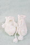Handmade sweet baby booties Royalty Free Stock Image
