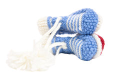 Handmade sweet baby booties isolated Stock Photo