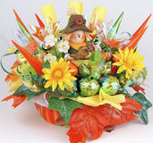 Handmade table decoration for thanksgiving holiday from candy. Square image of table decor for fall or thanksgiving holiday, gold, orange and green wrapped candy Royalty Free Stock Photo