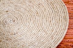 Handmade Table Mat of Jute Rope Twisted in a Spiral Form as Background. Handmade table mat of Jute Rope twisted in a spiral form Stock Photography