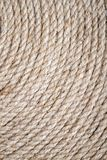 Handmade Table Mat of Jute Rope Twisted in a Spiral Form as Background. Handmade table mat of Jute Rope twisted in a spiral form Stock Photos
