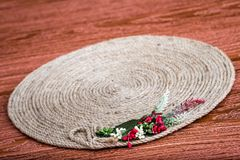 Handmade Table Mat of Jute Rope Twisted in a Spiral Form Stock Images