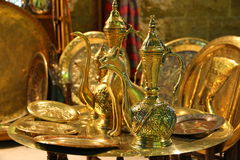 Handmade tableware. Egyptian handmade golden kettles and dishes royalty free stock images