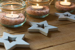 Handmade tea lights in jars with salt, wood decoration stars, close up, Christmas, New Year, advent Royalty Free Stock Photography
