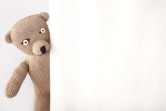 Handmade teddybear. With buttoneyes looking round the corner Royalty Free Stock Photos