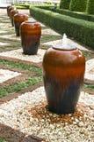 Handmade terracotta jar decorating a garden Stock Photography