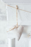 Handmade textile  white  heart  on a white background, rustic style. Romance consept Stock Images