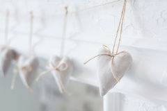 Handmade textile  white  heart  on a white background, rustic style. Romance consept Royalty Free Stock Image