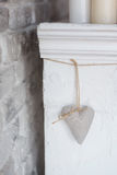 Handmade textile  white  heart  on a white background, rustic style. Romance consept. Stock Image