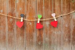 Handmade three wood hearts hanging on cloth line. Or rope Royalty Free Stock Photography