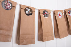 Handmade tinkered advent calendar with paper bags and stickers. Royalty Free Stock Photography