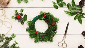 Handmade tools for making christmas wreath. On white wooden table, top view stock photo