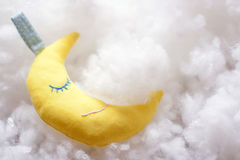 Handmade toy. Crescent of yellow fabric hand-sewn Royalty Free Stock Photos